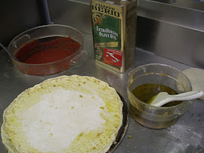 Photo: A very salty garlic olive oil for the best golden crust in town.  This is standard and comes on every pie.  Come in a watch for yourself from the counter. Do not say a thing, just come in an watch this process. You can see our process of pizza making right from the counter.