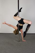 Photo: Vertical Pole Gymnastics - One Handed Back-Shoulder Handstand with Z Leg Line