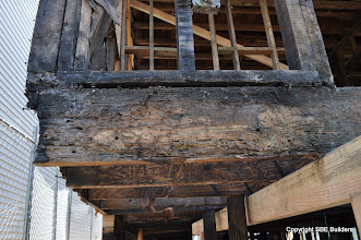 Photo: Termite damaged joist rim that needs to be replaced.