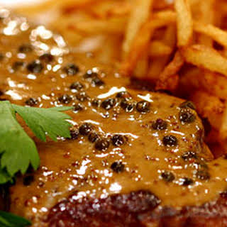 New York Strip with Green Peppercorn Sauce and Shoestring Frites.