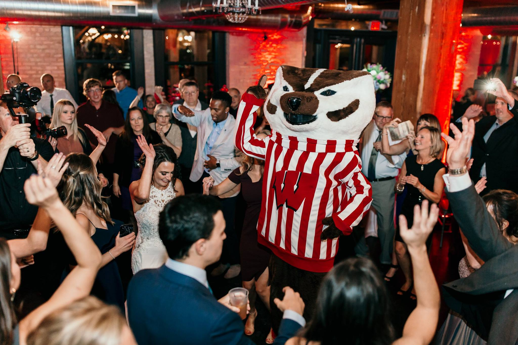 A wedding reception event with mascots and guests.