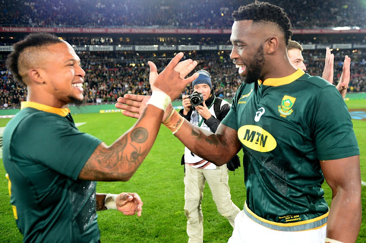 Elton Jantjies and Siya Kolisi for the Springboks celebrate winning the first Test against England at Ellis Park, June 9 2018. Picture: GALLO IMAGES