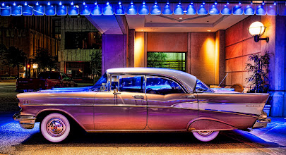 Photo: The 57 Chevy  This is a shot of a '57 Chevy.  I saw it when walking back to the Magnolia Hotel on Friday night after dinner in Dallas.  I took a photo of this pretty car under the blue lights of the porte-cochere, went upstairs to my room, downloaded the Topaz Bundle software, made the adjustments, and had the whole thing finished in less than 30 minutes.  That quick turnaround speaks to how easy the software is to use.  I've since used it on a number of other images, including some unpublished ones.  from the blog at www.stuckincustoms.com