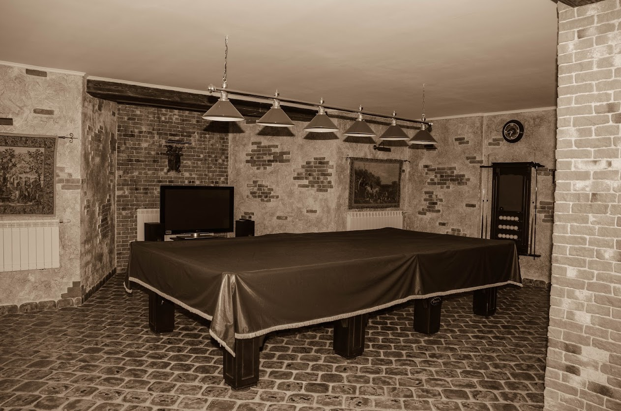 Интерьер гостевого дома в охотничьем стиле