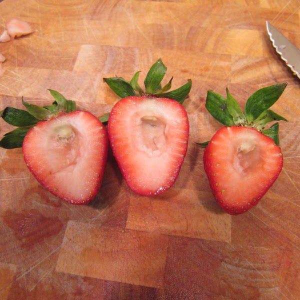 Wash and dry 1 pound of whole strawberries leaving on the green tops.  Cut one...