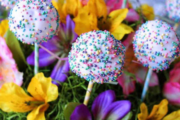 Three Easter Cake Pops Decorated With Sprinkles.