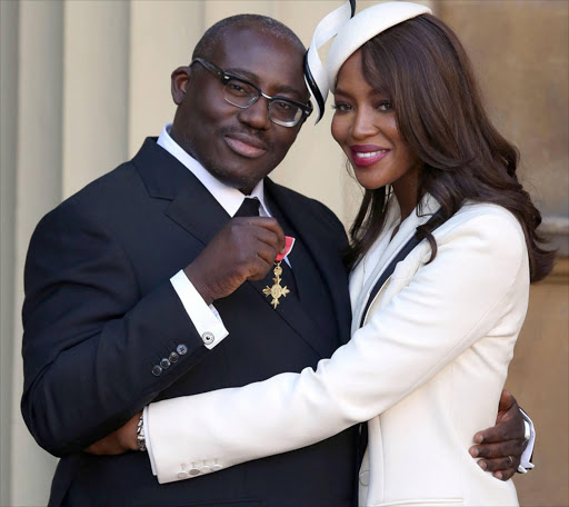 FILE PHOTO: Model Naomi Campbell (R) poses for a photograph with Edward Enninful, after Enninful received his Officer of the Order of the British Empire (OBE) at Buckingham Palace, in London, Britain October 27, 2016.  REUTERS