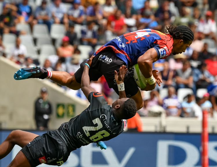 Aphelele Fassi of the Cell C Sharks tackles Courtnall Skosan of the Emirates Lions during the Super Rugby #SuperHeroSunday match at Cape Town Stadium on February 03, 2019.
