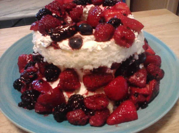 Slice cake with good bread knife. Drain but don't rinse berries.   Put largest cake on bottom...