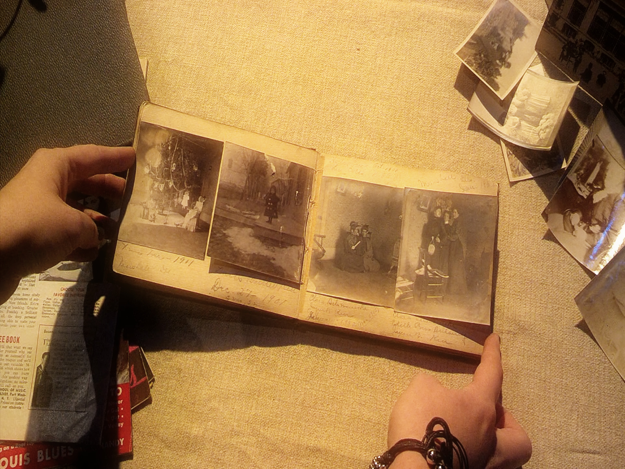 """Photo: Still from the music video for """"20 Years"""" by the Civil War, featuring the photo album of Jayne B. Kerr."""