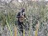 Hadzabe hunter preparing to shoot