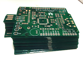 Photo: A stack of XOrduino Mk I PCBs
