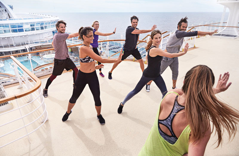 An instructor leads a fitness class on Princess Cruises.