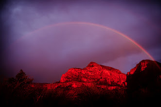 Photo: Well than you nature!  Rainy day in Sedona, we didn't even know if we'd get to see the sun at all and at the last moment you could see the sunset coming through a small but solid break in the clouds...and right behind us... a rainbow. So close I wish I could have run back to the car and get the 14mm because at 24mm it didn't fit. But in just a couple minutes it was gone.  The sunset was really powerful on those red rocks so that does represent no post process color editing.