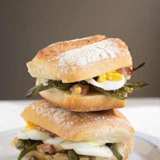 A Hearty Green Bean Sandwich with Bacon Aioli, Eggs, and Parmesan.