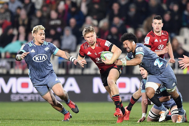 Jack Goodhue of the Crusaders is tackled by Ardie Savea of the Hurricanes during the round 7 Super Rugby Aotearoa match between the Crusaders and the Hurricanes at Orangetheory Stadium on July 25 2020 in Christchurch, New Zealand. Picture: GETTY IMAGES/ KAI SCHWOERER