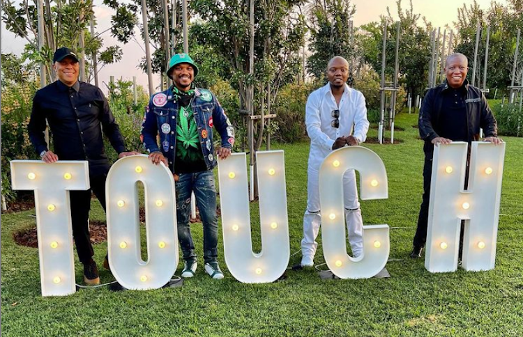 Doctor Khumalo, TT Mbha and Julius Malema (far right) were guests at Tbo Touch's birthday luncheon.