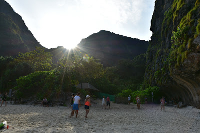 Sun coming up and the rays beaming down onto the soft white sands at 'The Beach'