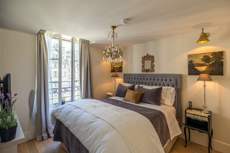 Luxury bedroom at Saint Place Dauphine Classic