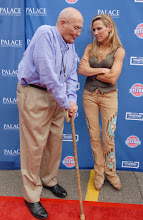 Photo: CLARKSTON, MI - AUGUST 12: (L-R) Representative John Dingell (D-MI) and Sheryl Crow attend the Palace Sports and Entertainment's Come Together Celebration concert at the DTE Energy Music Theater on August 12, 2012 in Clarkston, Michigan. (Photo by Paul Warner/Getty Images)