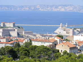 Photo: Now at the church, more than 530 feet above sea level, and looking down at the two forts, St-Nicolas (left) and St-Jean (right), guarding the Old Port entrance. Louis XIV had these built with guns pointing towards the city to keep the independent population under control – a fact that the feisty Marseillais are quite proud of!