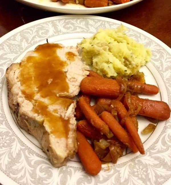 Pork Served With Aprict Pineapple Glaze, Garlic Smashed Potatoes, And Carrots.