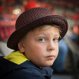 All Boy by Garry Dosa - Babies & Children Child Portraits ( spring, red, outdoors, candid, yellow, bokeh, stadium, hat, portrait, people, boy, child )