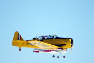 Photo: Vintage Wings Harvard 2866 CF-ROA flies by in formation with a couple of RVs
