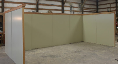 Photo: 10' x 20' Trade Show Booth made of torsion box honeycomb is lightweight, portable, and attractive.