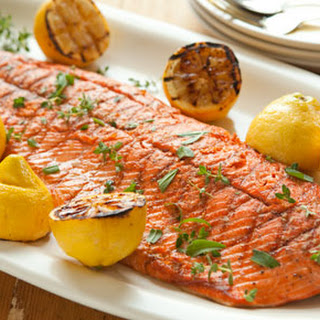 Grilled Salmon and Lemons with Herbs.