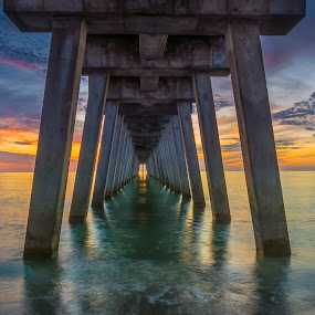 Sunset Under the Pier by Bill Camarota - Buildings & Architecture Bridges & Suspended Structures ( clouds, florida, sunset, gulf, pier, perspective, dusk, infinity )