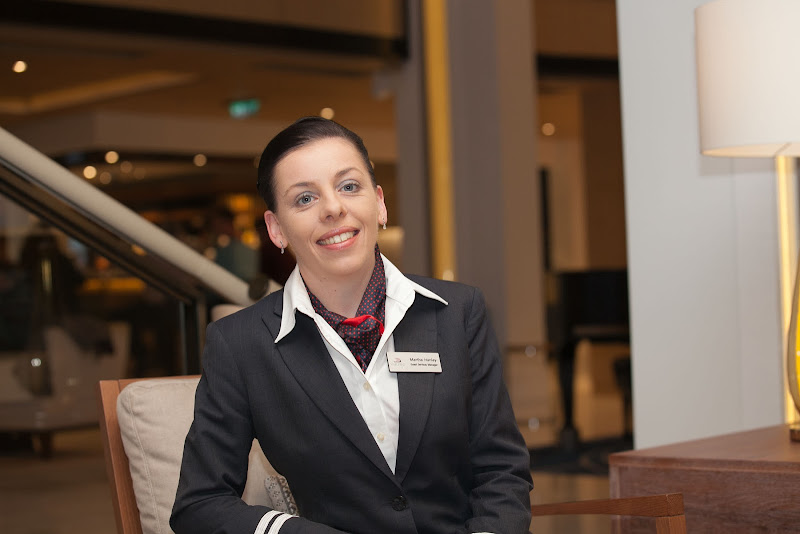 Martha Hanley, guest services manager of Viking Star, in the Atrium outside the Explorers Desk.