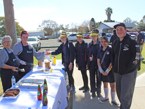 Donna Young and Olivia O'Meara from Narrabri and District Community Aid Service were busy at the sausage sizzle, here with Narrabri High School students Makayla Hopman, Kaitlyn Wall, Jazmin Bennett, Kianna Allen and Luke Dauthsearle.