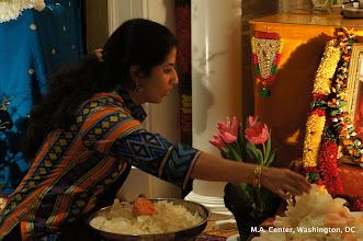 Photo: Priyanka putting petals at Amma's feet during Lalitha Sahasranamah Archana
