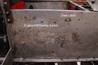 Photo: Photo of left-side aluminum side wall showing location of original engine kill toggle switch and (remains of) seat (tunnel cover) draw latch (logged/tagged as 2010-Jan-27 #2). Notice rusted/brown support brace on left angle up-right; this was to reinforce/repair a severed frame upright. A similar problem occurred on the right-side as well. Photo by Jack Loucks.