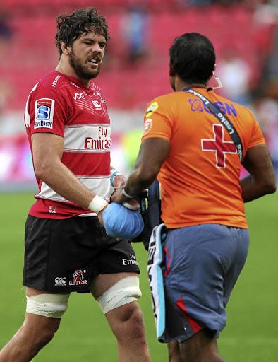 Down and out: A dejected Warren Whiteley leaves the field with a knee injury at Ellis Park on Saturday. Picture: GAVIN BARKER/BACKPAGEPIX