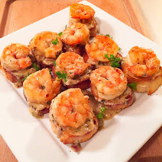 Shrimp with Whiskey Tarragon Sauce on French Bread.