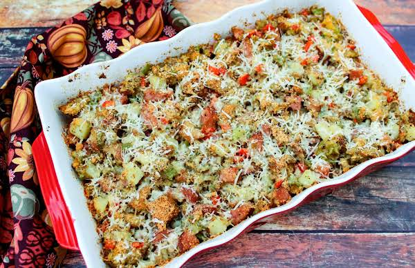 Sausage And Potato Stuffing Topped With Parmesan.