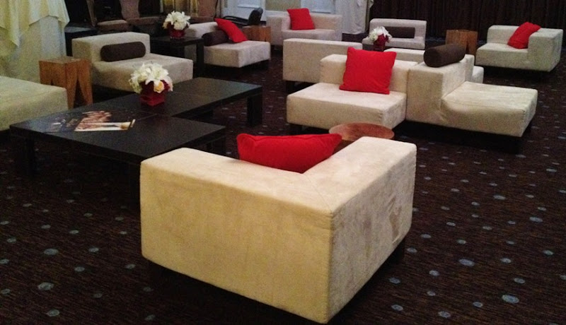 Photo: Gorgeous Lounge setting with the Modular Cube Chairs, Teak Side Tables & Leather Coffee Tables. — at The Beverly Hilton.