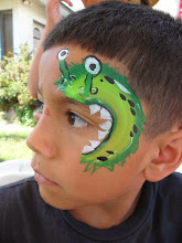 Photo: Monster face paint design by Heidi, La Verne. Book Heidi by calling 888-750-7024