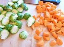 Preheat oven 375Cut brussel sprouts in half, small potatos cut in half, and carrots...