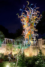"""Photo: Chihuly Courtyard Couple This is from the Chihuly exhibit at the Dallas Arboretum. I asked the young couple to hold """"real still"""" while I get this long exposure. They did a great job!"""