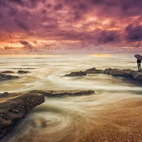 Contemplation by Raul Nunes - Landscapes Beaches ( clouds, water, sand, orange, purple, waves, woman, sunset, umbrella, sea, beach )