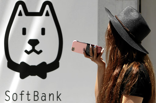 A woman walks outside a branch of SoftBank in Tokyo, Japan. Picture: REUTERS
