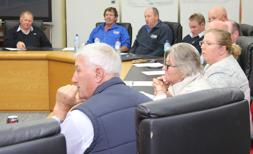 Kerry Sadler (Namoi Cotton), Mitchell Brodigan and Dale Smith (Namoi Logistics), Luke van der Broeke (Graincorp), Cr Ron Campbell, David Kneale and Cr Robert Kneale (all obscured), Susan Sims (Australian Rail Track Corporation), Liz Tomlinson (NSW Farmers) and Cr Ron Campey listen to a presentation at Thursday's meeting.