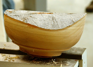 Photo: While roughing the outside, Ron felt like adding a feature, so he incorporated a ridge representing a kind of base on the lower part of the bowl. It was cut so that the shape of the bowl was pretty much the same on both sides, as if the band weren't there. This is a very pleasing shape. That's what's great about woodturning – you can do anything you want to!