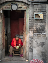 Photo: The social aspect is being lost in the hutong of Beijing. A woman is plucking old lettuce leaves off in her doorway. The main reason is-other than better light and space-is people who pass by ask her how her day is, whats for dinner, small gestures of kindness from neighbors.  http://mitchellmasilun.com/2013/11/14/winter-prep-begins-day-3365/  #china  #beijing  #asia  #hutongs  #culture +Close2Home curated by +Brett Sivits +David Pond +Pia Raben +Shaun Stewart +José Juan Escudero +Howard Weitzel +john adams