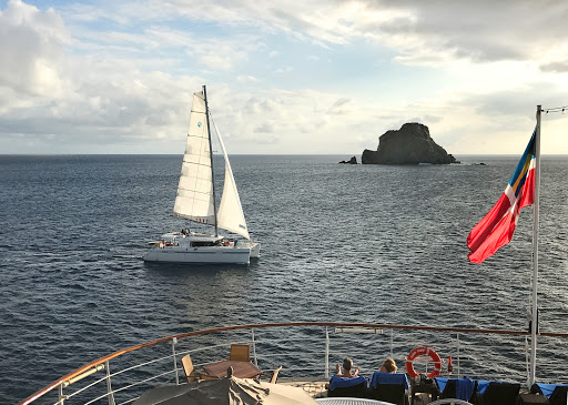 catamaran-at-sunset.jpg - A catamaran at sunset in St. Barts seen from the deck of Wind Surf.