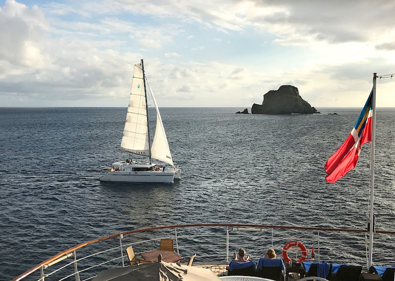 A catamaran at sunset in St. Barts seen from the deck of Wind Surf.