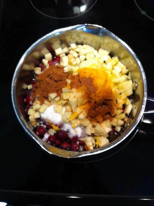 Put frozen cranberries into your sauce pan and add all the other ingredients into...